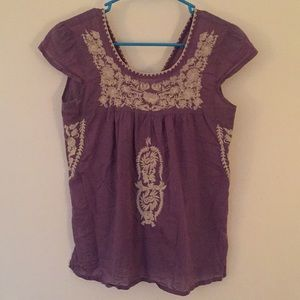 Purple embroidered top.